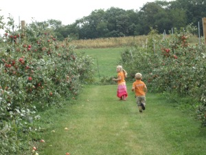 Running through the orchard.