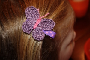 Crochet the butterfly, then hot glue onto a ribbon-covered double-prong clip.