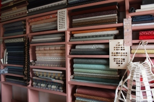 Old-fashioned fabrics lined one wall of the general store in Crossroads Village.