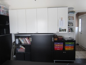 Upper white cabinets are from Ikea as well. The lower shelves are from the Galant line.  The shelf on the left is Ikea, but a discontinued line.  The multi-colored 12 x 12 plastic tubs?  Costco!  My other favorite place!
